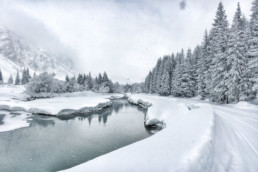The cross country skiing tracks along the river in Champagny