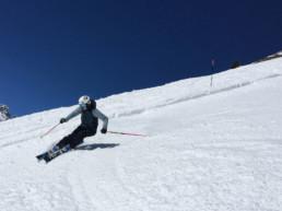 Julia skiing the spring snow on piste