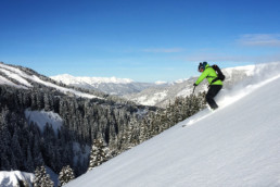 Skiing off piste powder slopes with a guide