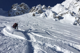 Skiing the deep snow off piste with a guide in Courchevel