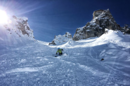 Skier skiing off piste in a Courchevel couloir